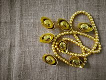 Chinese New Year celebration with decoration, gold ingots and golden pearls represent luxury and prosperity. Concept of wealth, new year and rich royalty free stock photography