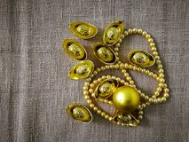 Chinese New Year celebration with decoration, gold ingots and golden pearls represent luxury and prosperity Royalty Free Stock Photo