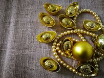 Chinese New Year celebration with decoration, gold ingots and golden pearls represent luxury and prosperity. Concept of wealth, new year and rich stock photos