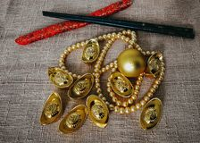 Chinese New Year celebration with decoration, gold ingots and golden pearls represent luxury and prosperity. Concept of wealth, new year and rich stock photography