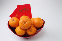 Chinese new year. Celebration mandarin oranges with ang pao