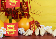Chinese New Year celebration party table on red and yellow wood background. Stock Photo