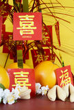 Chinese New Year celebration party table on red and yellow wood background Stock Photo