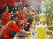 Chinese New Year Celebrations. Thai people of Chinese descent making offerings at Wat Traimitr temple during the Chinese New Year celebrations. Chinatown Stock Images