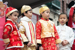 Chinese New Year Children Costume. Four Asian Amerian boys dressed in Qing (Manchu) Dynasty period costumes for the children's costume parade contest during the Stock Photos