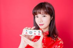 Chinese new year concept. Beauty woman show Mahjong - rich and 2019 ten thousand in chinese word royalty free stock photo