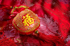 Chinese new year decor. Ations, lucky bag on red background. The Chinese character means lucky, not a logo or copyright Stock Photography