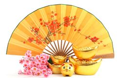 Chinese new year decoration. Traditional fan with Gold Ingot,Piggy Bank and Plum Blossom