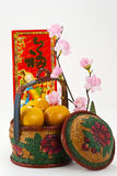 Chinese New Year decoration. Oranges in Vintage basket with flower and Blessing word royalty free stock photography
