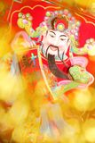 Chinese New Year Decoration. Chinese Mammon with festive bokeh