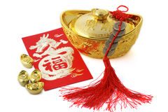 Chinese new year decoration. Blossom word with copper coins and gold ingots royalty free stock image