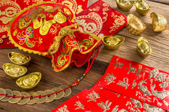 Chinese new year decoration,Chinese red bag and golden bullion Stock Photo