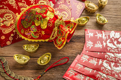 Chinese new year decoration,Chinese red bag and golden bullion Royalty Free Stock Images