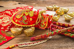 Chinese new year decoration,Chinese red bag and golden bullion Royalty Free Stock Photography