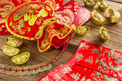 Chinese new year decoration,Chinese red bag and golden bullion Royalty Free Stock Photo