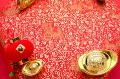Chinese new year decoration, close up golden ingots ang pow an. D lamp on red oriental pattern fabric hexagon box with chinese style pattern on red, Chinese stock photos