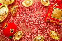 Chinese new year decoration,close up golden ingots ang pow an. D lamp on red oriental pattern fabric hexagon box with chinese style pattern on red,Chinese royalty free stock image