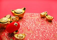 Chinese new year decoration,close up golden ingots ang pow an. D lamp on red oriental pattern fabric hexagon box with chinese style pattern on red,Chinese stock photography