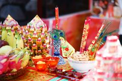 Chinese New Year Decoration. Festive food, fresh fruits and other set up for Chinese New Year festiveal with soft focus on the stock photo
