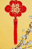 Chinese new year decoration items on yellow background. Royalty Free Stock Photo