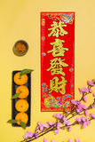 Chinese new year decoration items on yellow background. Stock Image