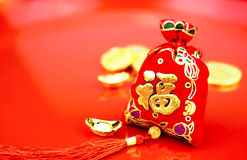 Chinese new year decoration: red felt fabric bag or ang pow with Royalty Free Stock Images