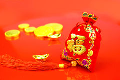Chinese new year decoration: red felt fabric bag or ang pow with Stock Photo