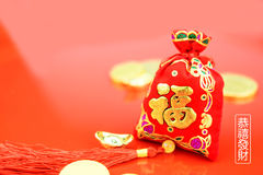 Chinese new year decoration: red felt fabric bag or ang pow with Royalty Free Stock Image