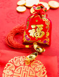 Chinese new year decoration: red felt fabric packet or ang pow w. Ith word prosperous and golden ingots on red fabric royalty free stock photo