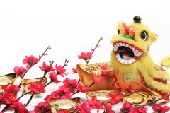 Chinese New Year Decorations. Traditional Dancing Lion,Gold Ingots and Plum Blossom