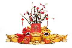 Chinese New Year Decorations. Traditional Dancing Lions,Gold Ingots,Red Packet and Plum Tree