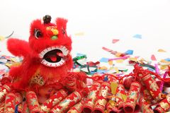 Chinese New Year Decorations. Traditional Dancing Lion,Firecrackers and Confetti