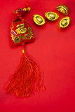 Chinese new year decorations and Auspicious ornaments on red bac Stock Photos