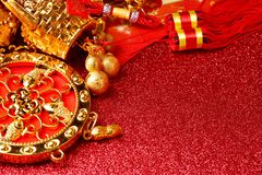 Chinese new year decorations and Auspicious ornaments on red bokeh background.  Royalty Free Stock Image