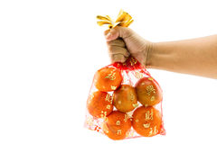 Chinese New Year decorations, orange bag auspicious Chinese char. Acters on a white background Stock Photography