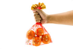 Chinese New Year decorations, orange bag auspicious Chinese char. Acters on a white background Royalty Free Stock Images