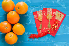 Chinese New Year Decorations orange and red envelope Stock Photos
