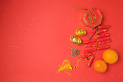 Chinese New Year decorations on red background. View from above with copy space Royalty Free Stock Images