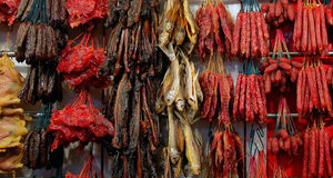 Chinese New Year Delicacies. Various types of waxed and preserved meats, fish and sausages, on sale prior to the Chinese New Year in Chinatown