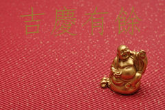 Chinese New Year design. Laughing cheerful Buddha Stock Images