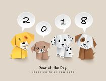 2018 Chinese new year greeting card design with origami dogs. 2018 Chinese new year  design with 4 origami dogs and speech bubbles Stock Photography