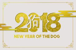 Chinese new year dog 2018 gold paper cut card. Chinese new year of the dog 2018 paper cut greeting card illustration in gold color with traditional calligraphy Stock Photos