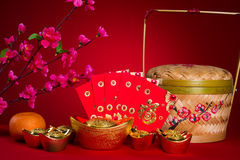 Chinese new year gold ingots and red packet stock image for Ang pow decoration