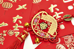 Chinese New Year. Festival decorations , the chinese character on the gold ingots means fortune and luck royalty free stock photos