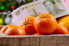 Chinese new year festival decorations orange wood basket Chinese yuan banknotes. Top view accessories Chinese new year festival decorations orange wood basket royalty free stock photos