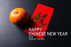 Chinese new year festival decorations,  red packets and mandarin oranges, golden Chinese letter means luck. Chinese new year festival decorations,  red packets Stock Image