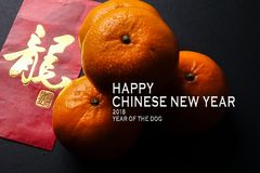 Chinese new year festival decorations,  red packets and mandarin oranges, golden Chinese letter means luck. Word of PROSPERITY ,ang pow or red packets and Stock Photo