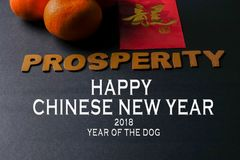 Chinese new year festival decorations,  red packets and mandarin oranges, golden Chinese letter means luck. Word of PROSPERITY ,ang pow or red packets and Royalty Free Stock Image