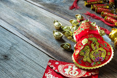 Chinese new year festival decorations on wooden table. Royalty Free Stock Photos