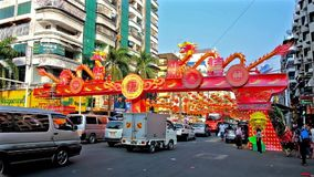 Chinese New Year Festival in Yangon, Myanmar. YANGON, MYANMAR - FEBRUARY 14, 2018: The holiday gateway to Maha Bandula road in Chinatown decorated with dragons stock video footage